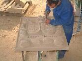 Escudos, esculturas, relieves y otros