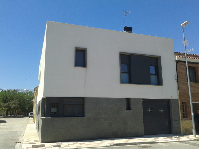 Realizaci n de una fachada para una vivienda en caparroso - Revestimiento de fachadas exteriores ...